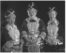 Hmong women in Laos in traditional costume. (BOHEMIAN NOMAD PICTUREMAKERS/CORBIS)